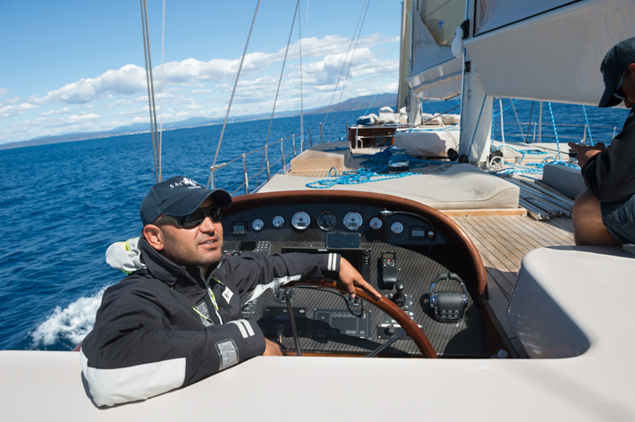 Captain Ali at the helm.
