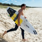 Joel heading for the water with his standard short board