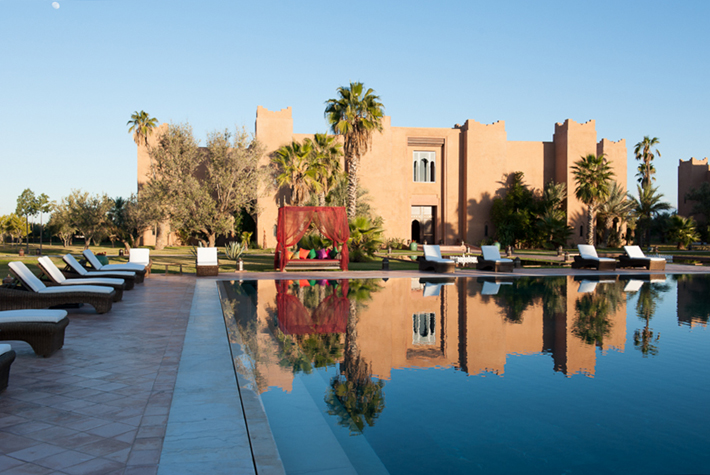 pool with riad in background